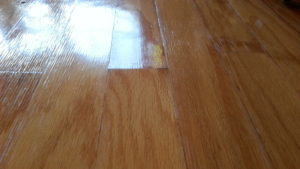 Peaked plank ends water damaged hardwood flooring